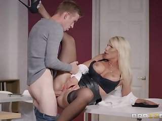 Milf in a leather mini main needs that huge cock inside her