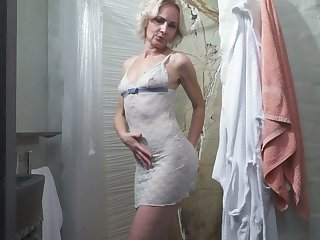Mature blonde Artemia is toying will not hear of old snatch in the shower