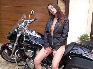 Kinky biker babe Caroline Ardolino desires to pet say no to twat in sensual mode
