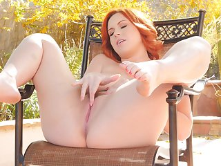 Busty redhead spreads will not hear of pussy and plays with tits unserviceable
