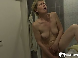 Showering comprehensive moans while masturbating on camera