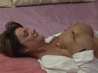 Blonde full-grown lesbians Dana DeArmond and Deauxma on the bed