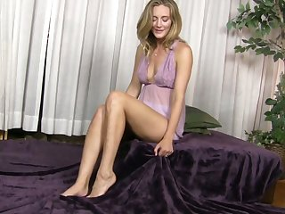 Horny mommy Mona Wales is masturbating her delicious sopping pussy on the bed
