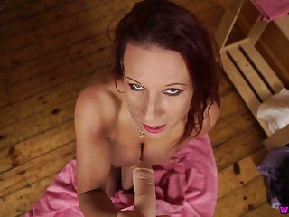 Svelte and rapacious Faye Rampton shows off her sucking skills on fake cock