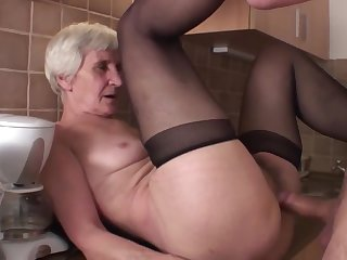 Viviana & Dieter skinny perishable granny in kitchen with Dieter