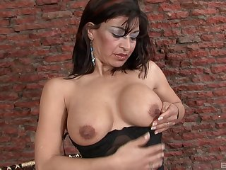 Seductive mature can't wait to put black dildo in the brush wet pussy