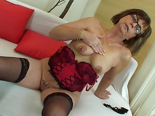 Mature amateur granny Jana strips and gets fucked away from a fat cock
