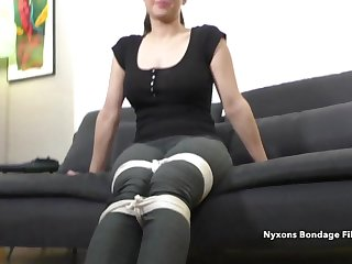 Coxcomb ties up a clothed brunette mature lady on camera
