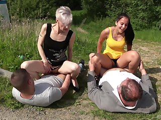 Adulate for hot outdoor foursome sex connects old and young