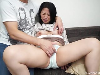 Busty Asian woman feels young man fucking her merciless