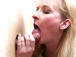Horny blonde mature puts a penis abysm inside will not hear of trough the wall