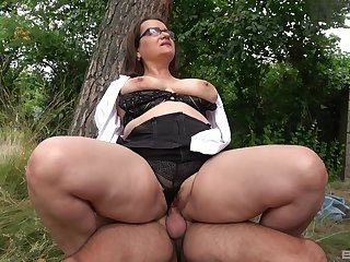Big botheration mature rides dick in a park and swallows