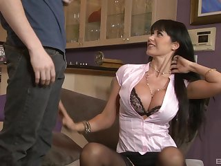 Mature mommy Eva Karera in stockings teaches a younger man about sex