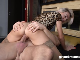 Horny blonde cougar gets the best of a strapping young buck